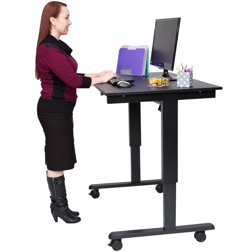 luxor h wilson stande 48 bk bo electric stand up desk with black frame and black desktop 48. Black Bedroom Furniture Sets. Home Design Ideas