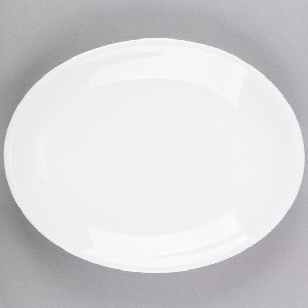 World Tableware 840-520R-9 Porcelana Rolled Edge 9 3/4 inch x 7 1/2 inch Bright White Oval Coupe Porcelain Platter - 24/Case