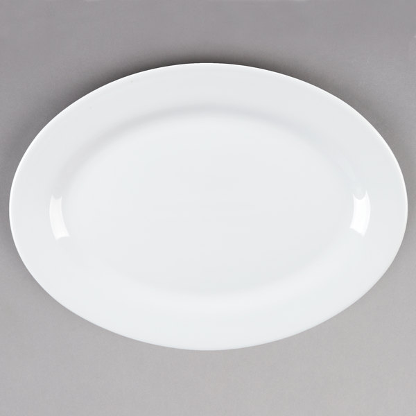 Tuxton ALH-136 Alaska 13 3/4 inch x 10 inch Wide Rim Rolled Edge Bright White Oval China Platter - 12/Case