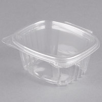 Genpak AD06 4 1/4 inch x 3 5/8 inch x 1 7/8 inch 6 oz. Clear Hinged Deli Container - 100/Pack