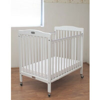 L.A. Baby CW883A White 24 inch x 38 inch Folding Wood Crib with 3 inch Vinyl Covered Mattress