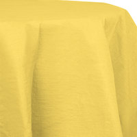Creative Converting 923266 82 inch Mimosa Yellow OctyRound Tissue / Poly Table Cover - 12/Case